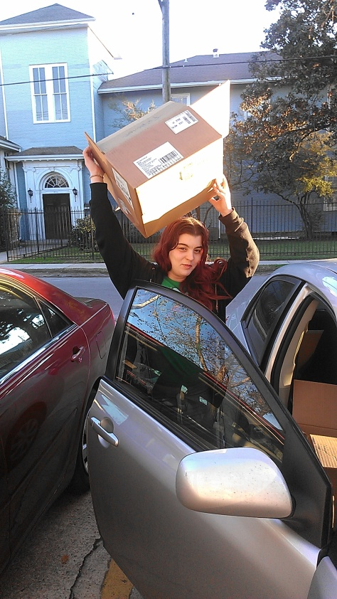 Olivia is a New Orleans resident who is moving to a new apartment. She picked up several boxes. (photo by Carlie Kollath Wells/New in NOLA)