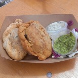 New in NOLA's Elena & Alaina shared these empanadas. (photo by Carlie Kollath Wells/New in NOLA)