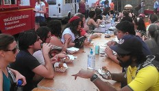 Sunday's food truck rally had one long table for everyone to eat together. (photo by Carlie Kollath Wells/New in NOLA)