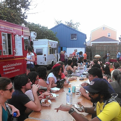Sunday's food truck rally had one long table for everyone to eat together. Good way to meet new people. (photo by Carlie Kollath Wells/New in NOLA)