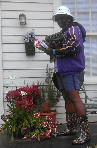 The severe weather in New Orleans yesterday didn't stop our mail carrier. (photo by Carlie Kollath Wells/New in NOLA)