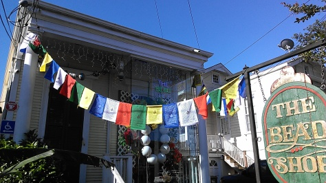 New Orleans businesses and restaurants have prayer flags up to welcome the Dalai Lama, who makes his first visit this week to New Orleans. (photo by Carlie Kollath Wells/New in NOLA)