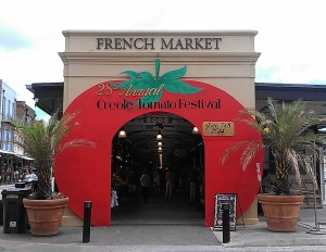 The entrance to the French Market has been transformed for the Creole Tomato Festival. (photo by Carlie Kollath Wells/New in NOLA)