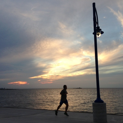sunset on Lakeshore Drive near Mardi Gras Fountain (photo by Carlie Kollath Wells, NewinNOLA.com)