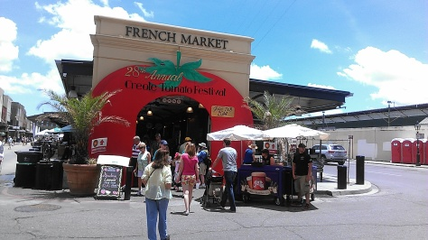 The French Market is a good spot to go for inexpensive feather masks and other New Orleans-themed souvenirs. (photo by Carlie Kollath Wells, New in NOLA)