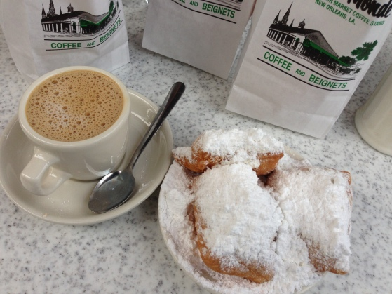 Necessary stop during any visit to New Orleans: beignets and cafe au lait from Cafe Du Monde. (photo by Carlie Kollath Wells, New in NOLA)